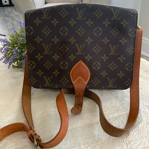 Authentic pre-loved Louis Vuitton Cartouchiere GM